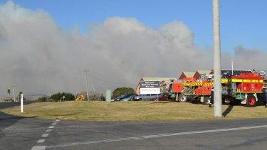 A bushfire burns in Milton near Ulladulla on Wednesday.