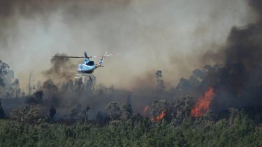 A helicopter works to fight the fire at Mount Clear.