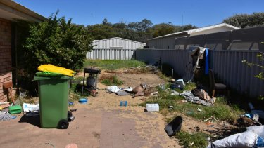 Junk and debris was left littering the yard when tenants vacated the property.