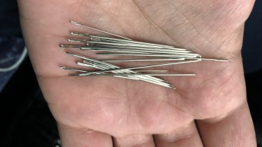 Needles found in a train seat on Tuesday.