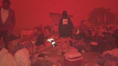 Evacuees at Mallacoota Wharf at10.30am Tuesday.
