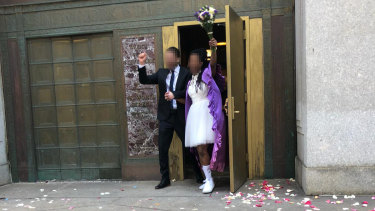 A couple, who do not want to be identified, celebrates after their wedding for immigration purposes in New York.