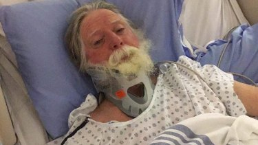 Phil Nelson, 65, is stuck in a Canadian hospital after receiving serious brain injuries.
