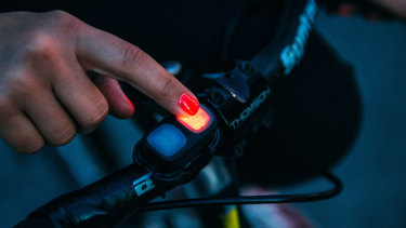 A wireless remote clips on to your handlebars.