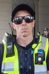 Victoria Police is investigating this officer who wore an 'EAD Hippy' sticker during the protests.