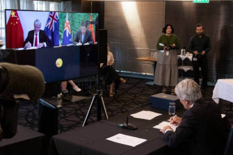 NZ Trade Minister Damien O'Connor and China's Commerce Minister Wang Wentao sign the upgraded free trade deal via video-link on Tuesday.