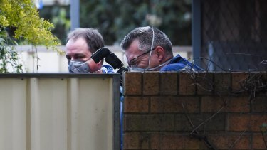 Police at the scene of a Wangaratta home where a body was found on Wednesday.