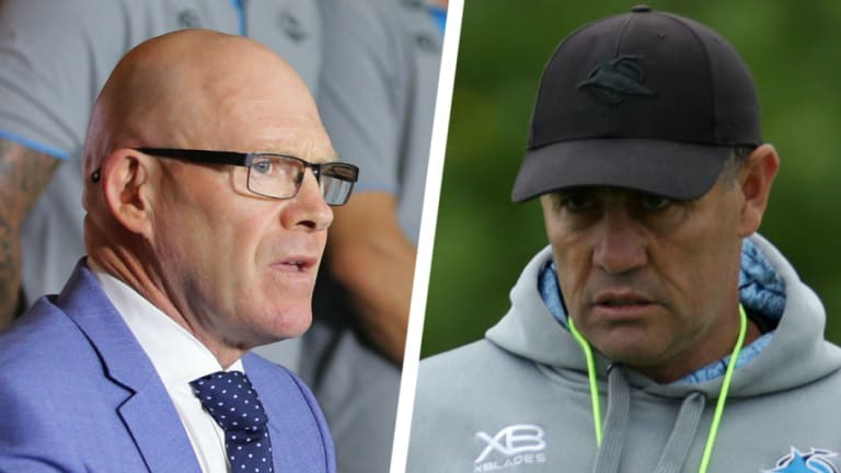 Man overboard: Sharks CEO Barry Russell addresses the media, and Shane Flanagan.