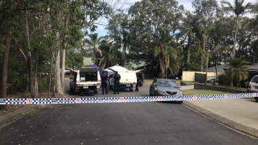 Police investigate after a man's body was found in the street in Barfoot Street, Bracken Ridge on Saturday.