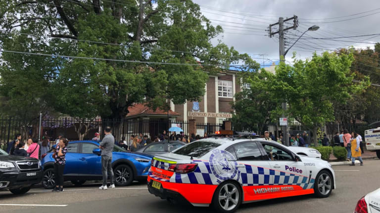 Police surround Eastwood Public School after a car crashed into the front fence on Thursday afternoon.