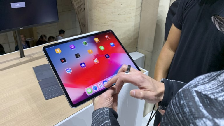 The iPads are big, but light enough to use one handed.