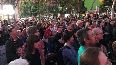 Anti-Adani protesters cross the Victoria Bridge in Brisbane on Friday.
