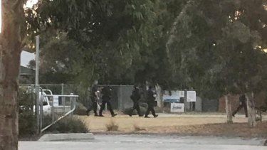 Special Operations Group officers at the scene in Pakenham