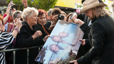 Barry Gibb meets fans at the official opening of the second stage of Bee Gees Way in 2015.