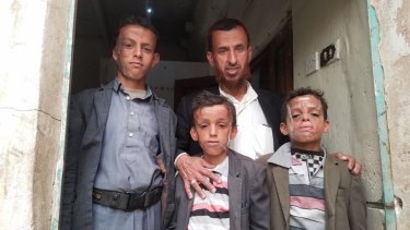 From left, Omar, 12, with his father Mohammed and brothers Ahmed, 10, and Abdul, 9, bear the scars of war.