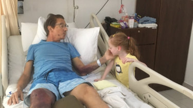 Duncan Turner and daughter Amelie as he received treatment in hospital overseas.