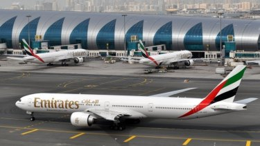 An Emirates plane taxis to a gate at Dubai International Airport at Dubai International Airport in Dubai, United Arab Emirates.