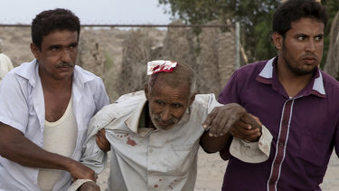 An injured civilian is brought to a field hospital in Yemen's Al Durayhimi district.
