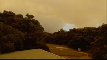 Bushfire smoke clouds out the sun near Cathedrals on Fraser Island on Saturday.