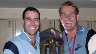 Posterity: Michael Bevan with Shane Lee after NSW's victory in the 2001 one-day final, then known as the Mercantile Mutual Cup.