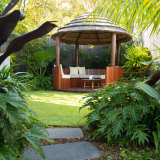 A circular gazebo adds coherence to the layout of the garden.