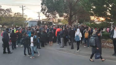 Commuters trying to get onto a replacement bus.