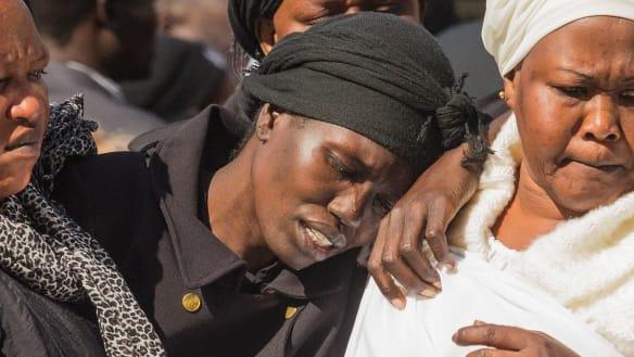 Sentence cut for mum who drove kids into lake, killing 3