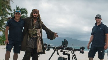 Stephen Oh, left, Johnny Depp as captain Jack Sparrow, and XM2 pilots in the Whitsundays during filming for Pirates of the Caribbean: Dead Men Tell No Tales. On set the drone became known as the 'Johnny Drone'.