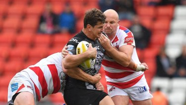 Untimely: Greg Bird, being tackled, has been sidelined by injury on the eve of the new season.