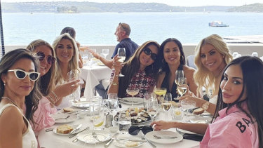 Last supper:  Sydney's ladies who lunch in pre-lockdown at Rose Bay's Catalina, from left Elaine Kwan, Maude Tzaneros, Barbara Coombes, unknown,  Laura Ibrahim, Elle Touma and Hannah Toohey.