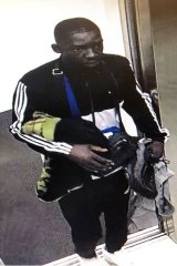 One of the men police wish to speak following aggravated burglaries in a Spencer Street apartment complex.