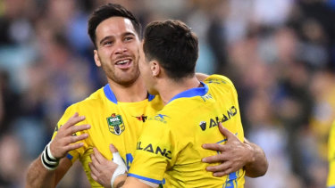 Growing pains: Corey Norman, left, seen here being congratulated by Mitchell Moses, failed to gel with his playmaking partner at the Eels last year after a spectacular start to their double act.