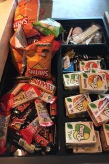 A drawer of leftover junk food given to Mr Wilkinson, his partner and mum.