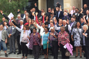 Noongar people and elders celebrating recognition on the steps of WA Parliament.