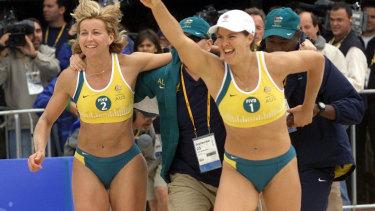 Kerri Pottharst and Natalie Cook celebrate their gold at Bondi.