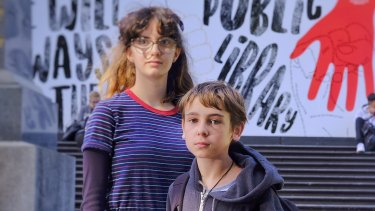 Zhana Maticevski-Shumack, left, with fellow YA reader Luca Fraillon on the steps of the State Library of Victoria.
