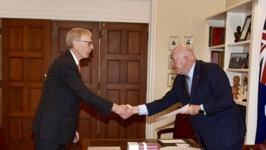 Commissioner Kenneth Hayne hands the final report of the banking royal commission to Peter Cosgrove.
