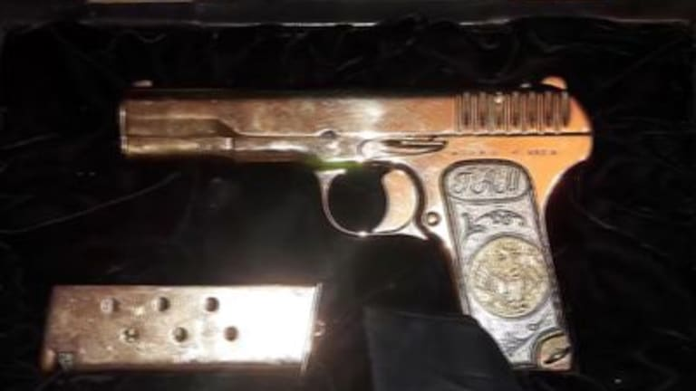 A gold-plated pistol Russian police found when they arrested a top official in the Dagestan region on suspicion of embezzlement.