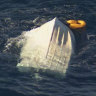 Bodies of three men located after boat capsizes off Wollongong