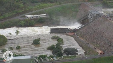 Water flows out of the Ross River Dam in Townsville after the floodgates were opened on Sunday night