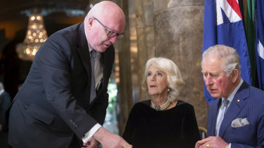 The Prince of Wales and his wife Camilla, the Duchess of Cornwall, sign the guest book with Australia's High Commissioner to the UK, George Brandis, at Australia House in London.