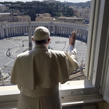 Pope Francis delivers his blessing from inside the Apostolic Library at the Vatican on Sunday.