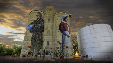 Art from the heart: the mural the people of Devenish, in northern Victoria funded on its old silos depicts two service women, 100 years apart: a WWI nurse and a modern day army medic.