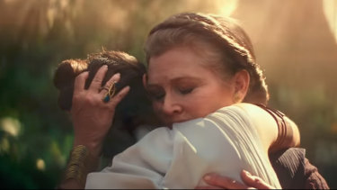 Rey (Daisy Ridley) is embraced by General Leia (Carrie Fisher) in The Rise of Skywalker.