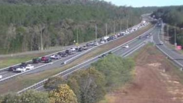 A south-facing traffic camera shows delays on the Bruce Highway at Glasshouse Mountains about 3pm on Sunday.