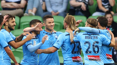 Sky's the limit: Sydney FC players celebrate after Adam Le Fondre put his side on the path to claiming bragging rights in the Big Blue at AAMI Park.
