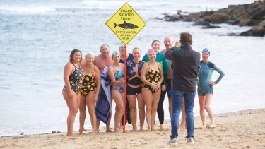 Swimmers brave the waters at Shelly Beach on Saturday.