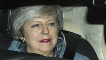 Britain's Prime Minister Theresa May leaves the Houses of Parliament in Westminster following a Brexit vote in the House of Commons.