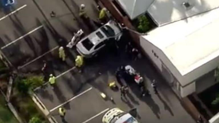 A driver crashes through a garden bed and into a building at Aspley.