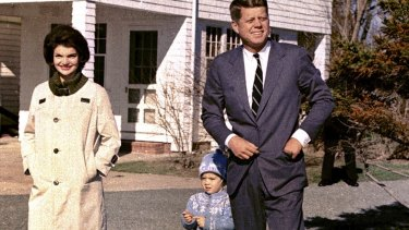 John F. Kennedy takes a stroll with his wife Jacqueline Kennedy and their daughter Caroline at Hyannis Port, Massachusetts in 1960.